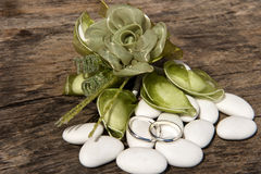 Weeding Favors  and wedding rings Stock Photos