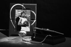 Weeding memories. A view with memorable wedding photo and a bouquet with roses Stock Images
