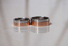 Weeding rings. On table with reflection Stock Photos