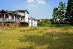 Weedy ground before Chinese traditional buildings in sunny summe Stock Photography