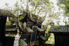 Weedy roof of ancient Chinese gateway Stock Photo