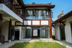Weedy yard of newly built archaised Chinese house on sunny day Stock Images
