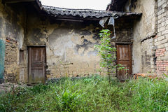 Weedy yard of ruined Chinese dwelling house Stock Image