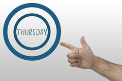 Week days concept. Hand pointing a circle with text: thursday.  stock images