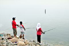 Week End Family Fishing. Photo of a family fishing at danga bay johor mlaysia, one of famous week end fishing spot for locals Stock Images