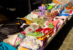 A week-end scene in the windward islands. Clothing for sale at a stall on back street in st. vincent Royalty Free Stock Photography