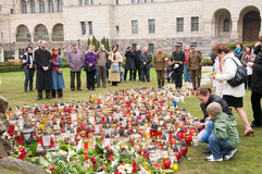 Week of mourning in Poland. People visiting Monument of Katyn Victims to commemorate plane crash. Begin of week of mourning in Poznan, Poland Royalty Free Stock Photo
