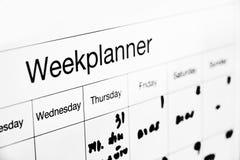 Week planner board. On wall stock photo