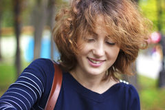 Weekday happy. Portrait of a young woman on the street Stock Images