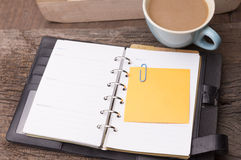 Weekend concept. Pink rose, mug with coffee, diary and stcky not Royalty Free Stock Photography