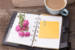 Weekend concept. Pink rose, mug with coffee, diary and stcky not Stock Image