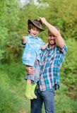 Weekend at farm. Little boy and father in nature background. Spirit of adventures. Little helper in garden. Child having. Fun cowboy dad. Farm family. Holidays royalty free stock photos