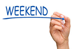 Weekend - female hand writing blue text. On white background royalty free stock photos