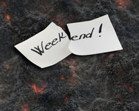 Weekend. Hand writing text on a piece of paper on lawa background Stock Photo