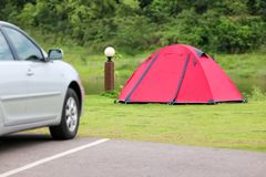 Weekend holiday in campsite and tents on the lawn and car park w. Ith beautiful green nature landscapes of dam water, forests, and mountains in Thailand stock photo