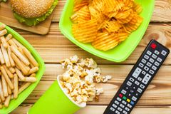 Weekend at home, leisure lifestyle, TV, fast food concept. stock photo