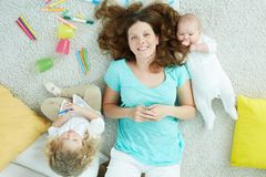 Weekend idyll. The above-view portrait of a charming mother relaxing with her kids on the weekend Stock Photography