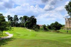 Weekend jouer au golf Photos stock