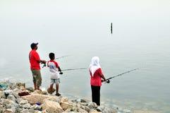 Weekend la pesca della famiglia Immagini Stock