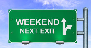 Weekend next exit road sign. Royalty Free Stock Photos