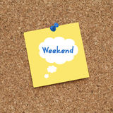 WEEKEND. Note pinned on cork noticeboard Royalty Free Stock Images