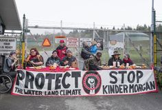 Protesters at the Kinder Morgan tank farm in Burnaby, BC, 2018. Pipeline protesters serve breakfast before five people are arrested at the Kinder Morgan tank royalty free stock photography