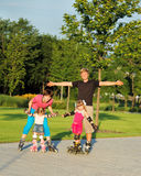 Weekend in roller skates. A happy family enjoying weekend in roller skates Royalty Free Stock Photography