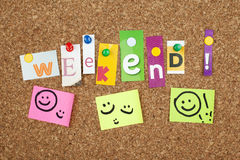 WEEKEND. Single letters and smiley faces pinned on cork noticeboard Royalty Free Stock Photo