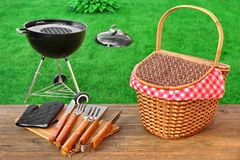 Weekend Summer Outdoor BBQ Party Ot Picnic Scene. Weekend Summer Outdoor BBQ Grill Party Ot Picnic Conceptual Scene With Picnic Wood Table, BBQ Tools, Hamper And stock image