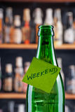 Weekend Time. Green beer bottle with a weekend note Royalty Free Stock Photo