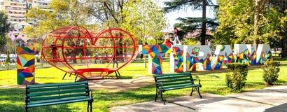 Weekend in Tirana Youth Park. Tirana, Albania. October 29, 2017: Youth park in Tirana and kids playing on the installation I Love Tirana, sunny Sunday afternoon Stock Image