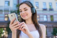 Weekend vacation relax rest student sound concept. Closeup photo portrait of cheerful dreamy glad pretty dreamy peaceful she her. Lady holding using telephone stock photo