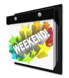 Weekend Word on Wall Calendar Fun Plans Time Off. A wall calendar with the word Weekend in a colorful starburst representing the anticipation you have for your Royalty Free Stock Photography