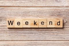Weekend word written on wood block. weekend text on table, concept royalty free stock photos