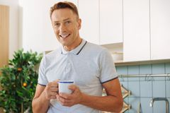 Happy delighted man resting at home Royalty Free Stock Image