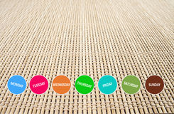 Weekly button on bamboo matt Fotografia Stock