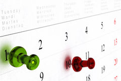 Weekly calendar. With green thumbtack pointed on number one, and red pushpin pointing on number ten, blur effect and perspective view Stock Photos
