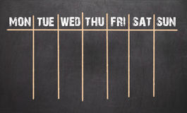 Weekly Calendar on chalkboard background. 7 day plan Royalty Free Stock Photos