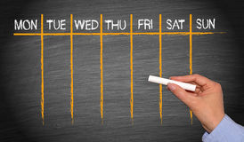 Free Weekly Calendar - Female Hand With Chalk Writing On Blackboard Royalty Free Stock Photo - 97427685