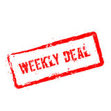 Weekly deal red rubber stamp isolated on white. Stock Photos
