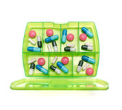 Weekly medicine. Box with a weekly dosage of various drugs on a white background Stock Photos
