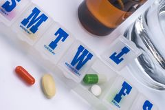 Weekly pillbox with medication, conceptual image. Horizontal composition stock images