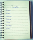 Weekly plan on notebook Stock Photos