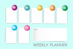 Weekly planner with a blank spiral notebook stock image
