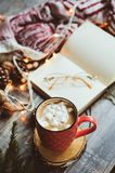 Weekly planner or to do list top view with Christmas decorations and hot cocoa. Choosing gifts and planning holidays concept Royalty Free Stock Photo