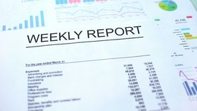 Weekly report lying on table, graphs charts and diagrams, official document. Stock photo vector illustration