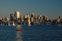 Weekly sailboat race at sunset Stock Photo
