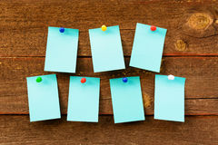 Weekly schedule with blue empty stickers on brown wooden backgro. Und. School schedule planning concept Stock Photography