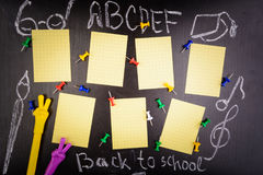 Weekly schedule with pins and two pens. On black table. Back to school concept Stock Photos