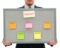 Weekly target. Businessman holding a reminder board with the target for the week Royalty Free Stock Photography